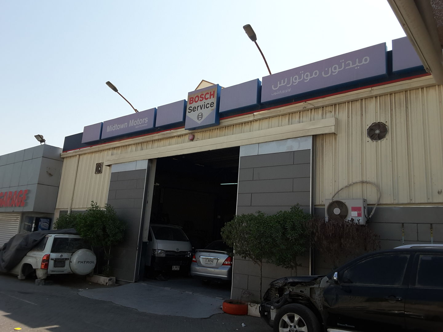 HiDubai-business-midtown-motors-auto-workshop-transport-vehicle-services-car-assistance-repair-al-quoz-industrial-1-dubai-2